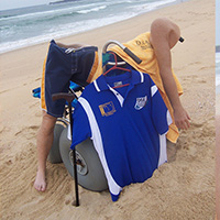 Prosthetic limbs, beach wheelchair and walking cane on a beach