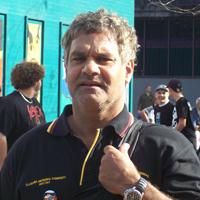 Richard wearing a black Illawarra Aboriginal Community shirt