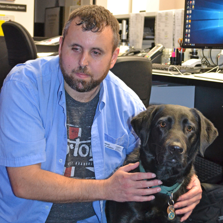 Danny with his guide dog