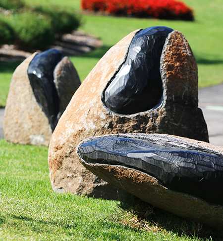 detail of Andreas Buisman's sculpture showing three large rocks with coal cross-sections