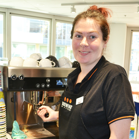 Jessica working at a coffee machine