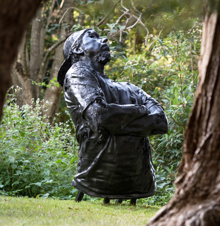 Louis Pratt's sculpture 'King Coal' featuring the head and torso of a man wearing a cap backwards with his arms crossed