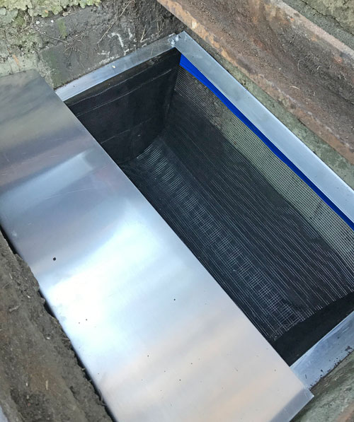 stainless steel drain buddy fitted in a stormwater drain